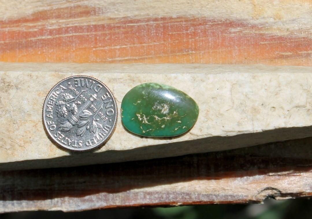 A natural dark green Stone Mountain Turquoise cabochon   $12 for 4.6 carats untreated & un-backed Nevada turquoise.