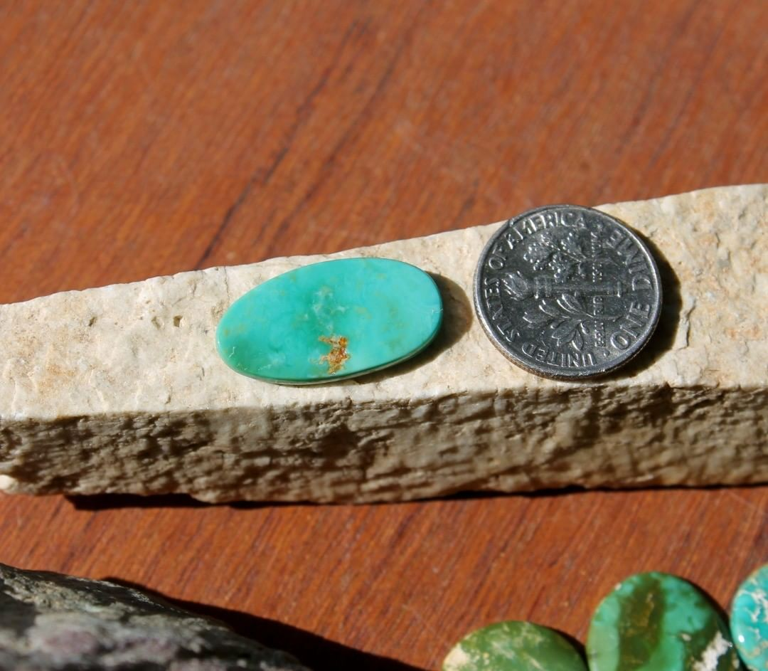 A natural teal green turquoise cabochon oval (Stone Mountain Turquoise)  $16 for 5.8 carat untreated Nevada turquoise.