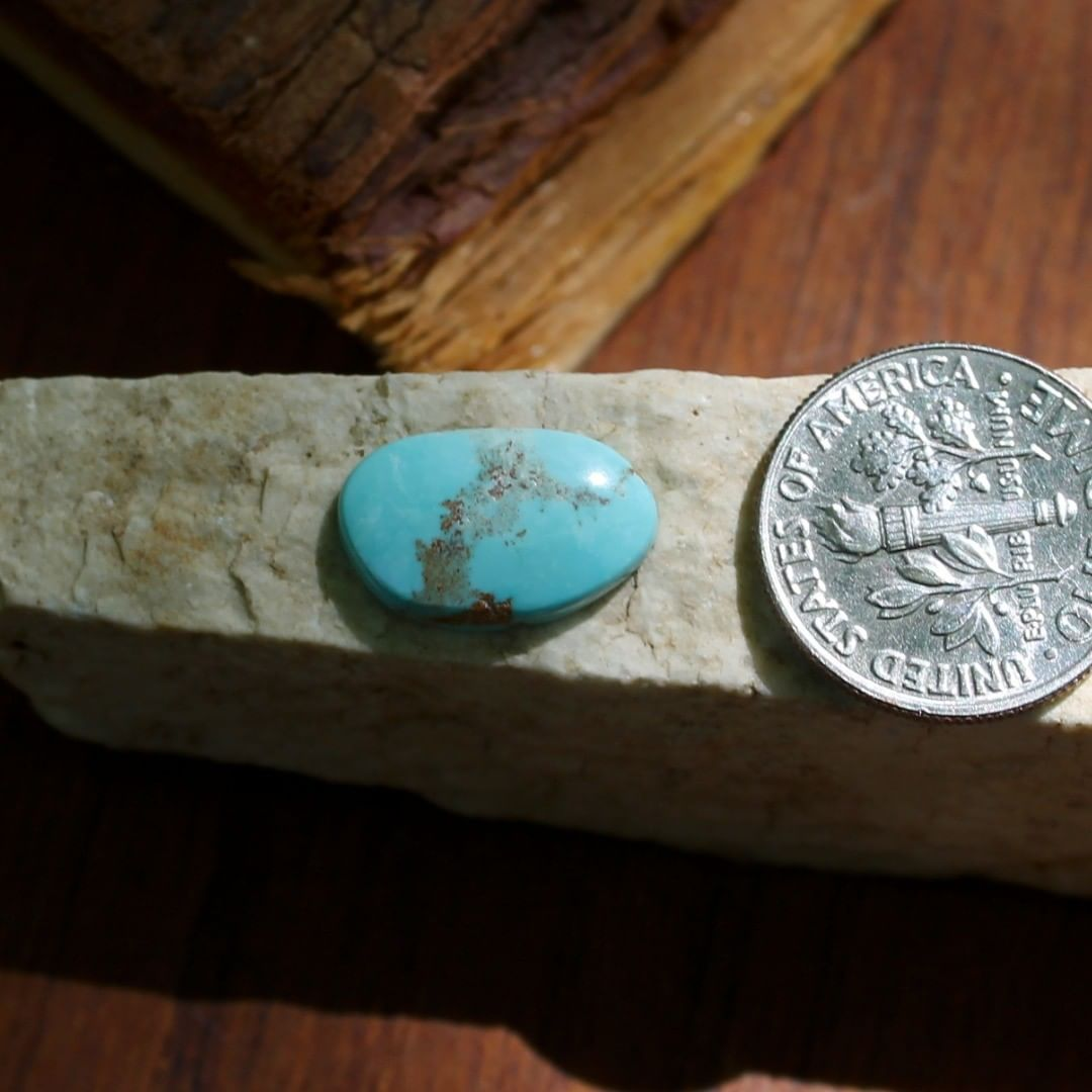 Natural blue turquoise cabochon w/ red inclusions (Stone Mountain Turquoise)  $8 for 3.0