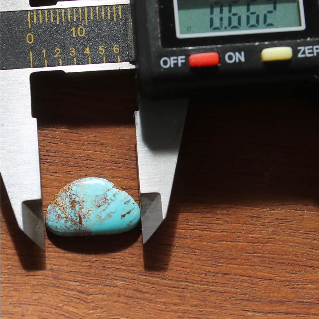 Natural blue turquoise w/ red inclusions (Stone Mountain Turquoise) DM for inquiries $11 for 4.4 carats untreated & un-backed Nevada turquoise.