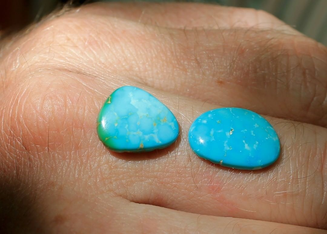 A couple natural blue cabochons with light colored inclusions. Un-backed and untreated.  $23 for 4.4 & 3.9 carats