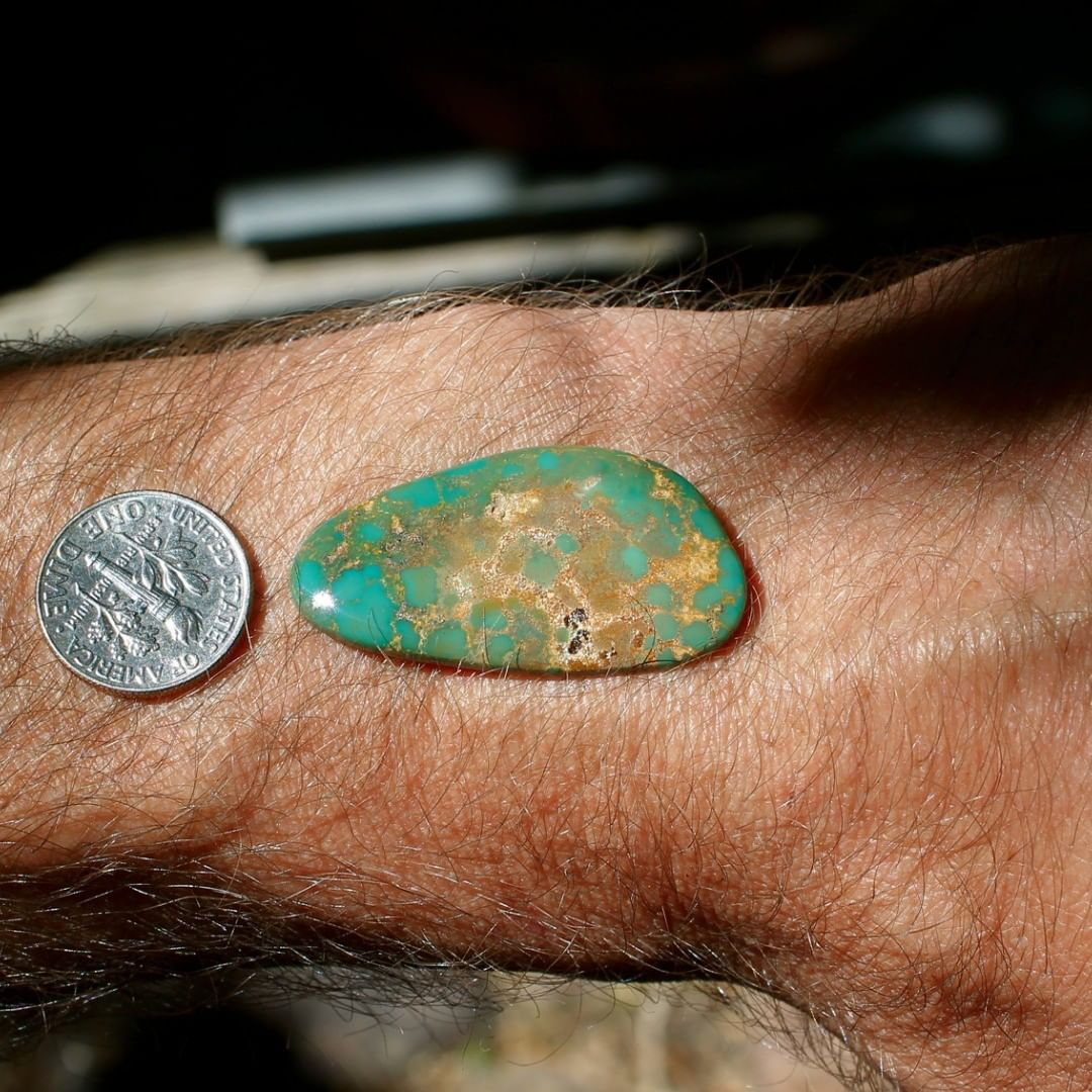A natural green cabochon with spiderweb inclusion pattern.   $60 for 21.4 carats un-backed and untreated